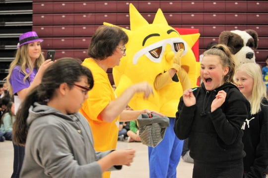 Sonoma Elementary School fifth grader Emme Strand, at right, was overjoyed to draw a ticket assigning her to the green Guardians house during a ceremony on Friday, Feb. 21, 2020.