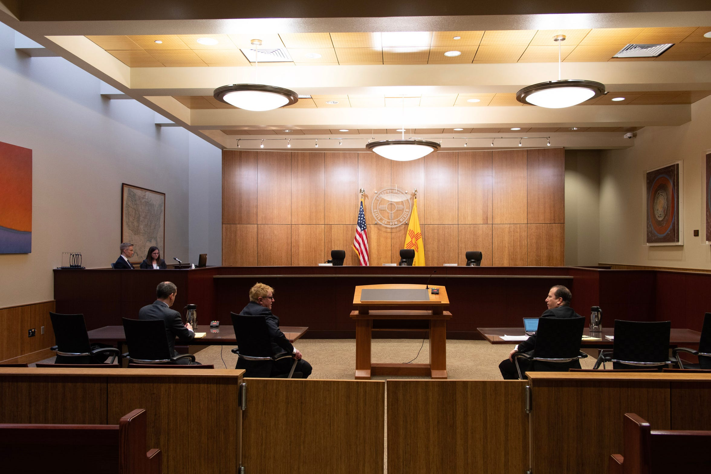 Attorneys wait for the judges to arrive to hear oral arguments in the New Mexico Court of Appeals in Albuquerque.