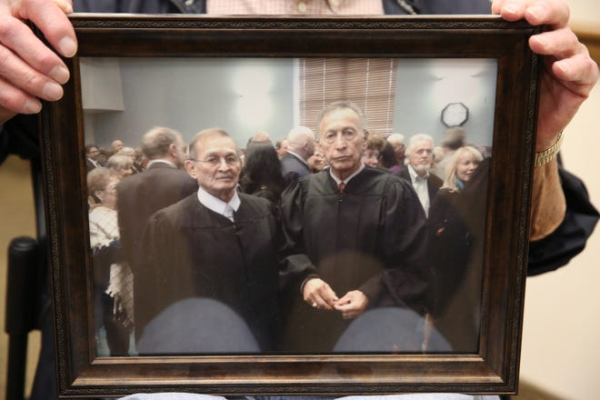 From left, a framed a photo of Lionel Frietze and his brother Oscar. Frietze, the municipal judge for the Town of Mesilla, passed away Feb. 5.
