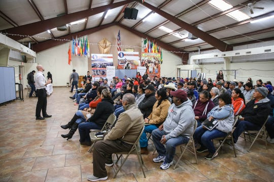 Dozens of people attend a migrant farmer resource fair in Hatch on Friday, Feb. 21, 2020.