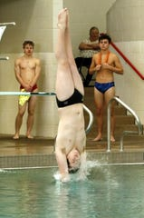 Farmington's Helaman Seavey competes a dive in the morning session of the NM state swimming and diving championships at Albuquerque Academy on Feb. 21, 2020. He finished Day 1 in 10th place with 257.10 points.