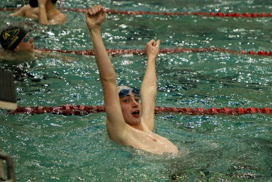 Carlsbad's Matthew Pavlik reacts when he sees his 50-yard freestyle time was good enough to advance to the championship round of the New Mexico state swimming and diving meet at Albuquerque Academy on Feb. 21, 2020.