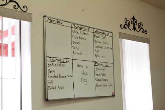 The weekly menu is displayed on a white board on the wall, Wednesday, Feb. 19, 2020, at Blanco Senior Center.