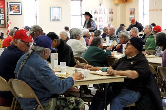 A crowd gathers for lunch, Wednesday, Feb. 19, 2020, at the Bonnie Dallas Senior Center in Farmington.