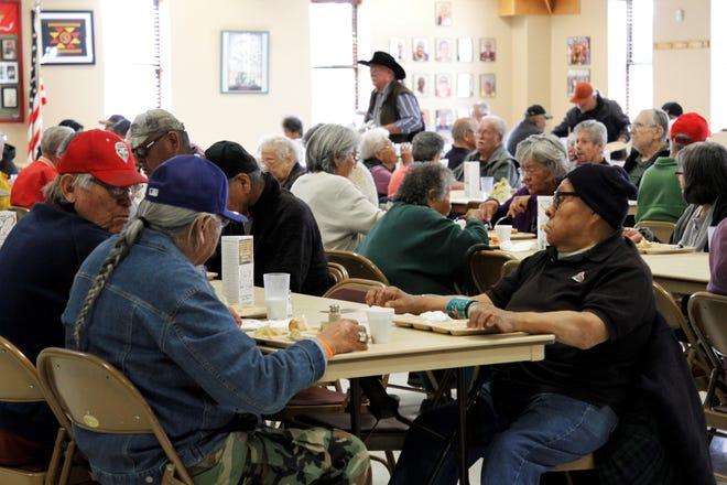A crowd gathers for lunch, Wednesday, Feb. 19, 2020, at the Bonnie Dallas Senior Center in Farmington.