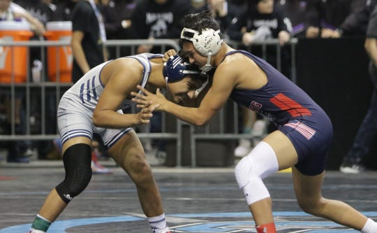 Piedra Vista's Diego Martinez and Deming's Estevan Carreon do battle in a 5A 138-pound first-round match during Friday's New Mexico State Wrestling Championships at the Santa Ana Star Center in Rio Rancho.