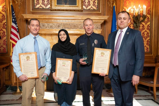 Ken Levine, Duaa Ahmad and Officer Michael Wissink were recognized Thursday at the Assembly session. Rep. Gordon Hintz presented the awards.