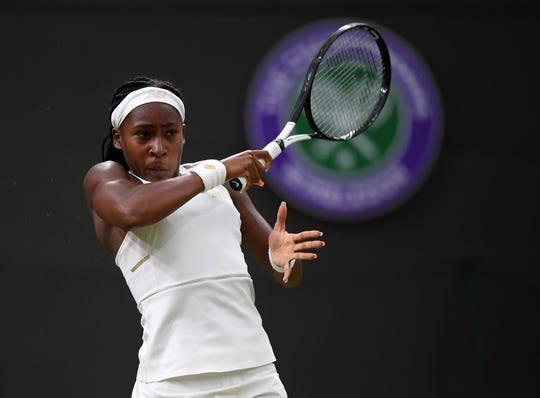 Coco Gauff of the United States plays a forehand in her Ladies' Singles second round match against Magdalena Rybarikova during Day three of The Championships on July 03, 2019 in London, England.