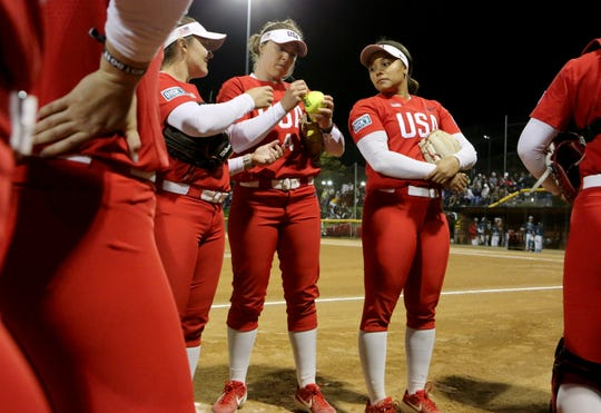 Amanda Chidester of USA Olympic softball team signs a softball along with the rest of the team prior to the game against New Mexico during the Mary Nutter Classic college softball tournament at Big League Dreams Sports Park in Cathedral City, Calif., on February 20, 2020.