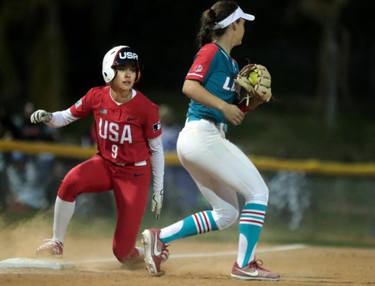 Janie Reed of the USA Olympic softball team slides into third base against New Mexico during the Mary Nutter Classic college softball tournament at Big League Dreams Sports Park in Cathedral City, Calif., on February 20, 2020.