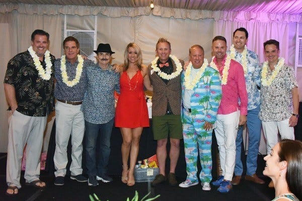 Event co-chairs BB Ingle and Jamie Steinberg pose with cabana boys Sean Webb, Craig Michaels, Troy Kudlac, Ken Harth, Brandon Boswell, Dylan McCrum and Marco Rosetti.