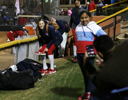 Monica Abbott of the USA Olympic softball team poses for a photo with Melody Rodriguez, 9, of Indio during the Mary Nutter Classic college softball tournament at Big League Dreams Sports Park in Cathedral City, Calif., on February 20, 2020.
