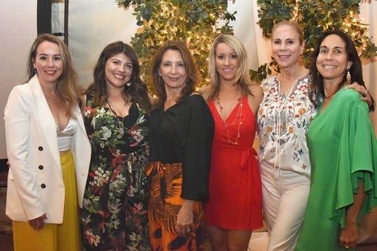 The women of Girlfriend Factor, Erica Espinola, Shay Moraga, Elli Tourje, Jamie Steinberg, Jan Harnik and Celeste Varela, smile for the camera.
