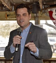 """U.S. Rep. Matt Gaetz speaks Friday speaks to the crowd at the """"Open Gaetz Day"""" stop at Hub Stacey's in Innerarity Point."""