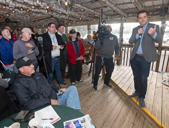 """U.S. Rep. Matt Gaetz talks Friday with constituents at Hub Stacey's at the Point on Innerarity Point during an """"Open Gaetz Day"""" stop."""
