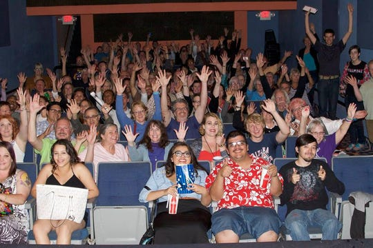 Audience members celebrate at The Screening Room during the 2016 Arizona International Film Festival.