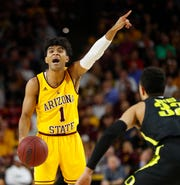 ASU's Remy Martin (1) calls out to his team against Oregon's Anthony Mathis (32) during the first half at Wells Fargo Arena in Tempe, Ariz. on Feb. 20, 2020.