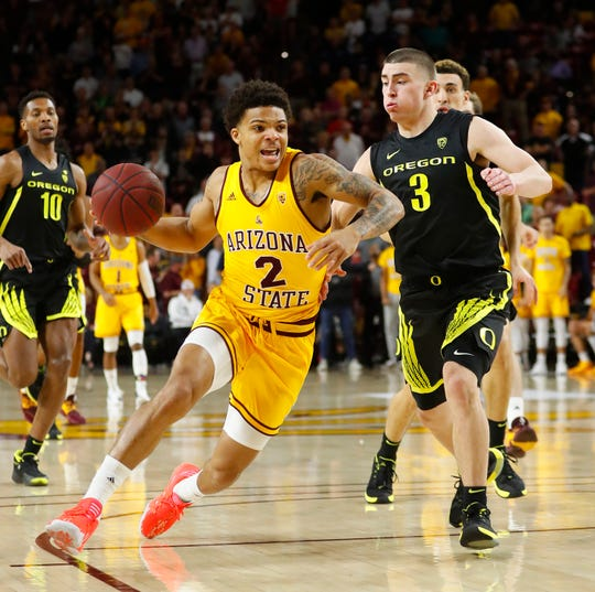 ASU's Rob Edwards (2) drives down the court against Oregon's Payton Pritchard (3) during the first half at Wells Fargo Arena in Tempe, Ariz. on Feb. 20, 2020.