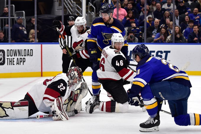 Feb 20, 2020; St. Louis, Missouri, USA;  Arizona Coyotes goaltender Antti Raanta (32) makes a save against St. Louis Blues center Tyler Bozak (21) during the second period at Enterprise Center. Mandatory Credit: Jeff Curry-USA TODAY Sports