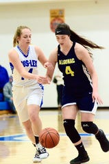 Algonac's Emily Nugent fights to maintain control of the ball during a Blue Water Area Conference girls basketball game on Friday, Feb. 21, 2020, at Croswell-Lexington.