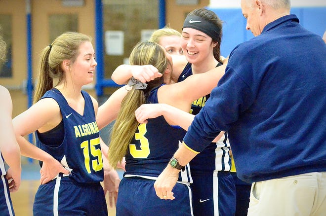 Algonac's Emily Nugent gets a hug from Alyssa Semaan after scoring her 1,001st-career point during a Blue Water Area Conference girls basketball game on Friday, Feb. 21, 2020, at Croswell-Lexington.