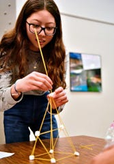 Dallastown sophomore Jessica Coulson, 16, does her part as more than 75 students from nine York County schools participate in the STEM challenge activity during Introduce a Girl to Engineering Day at Buchart Horn Inc. in York City, Thursday, Feb. 20, 2020. Dawn J. Sagert photo