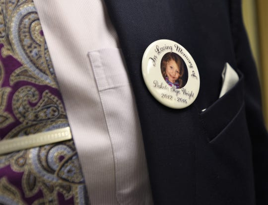 A button that honors the memory of 4-year-old Dakota Wright is shown on the suit jacket of Hanover Borough Police Sgt. Matthew Waltersdorff. He and Hanover Borough Police Officer Jared Auman, the lead investigator in the hit-and-run that claimed the little girl's life, were honored during an awards ceremony at the York County Administrative Center