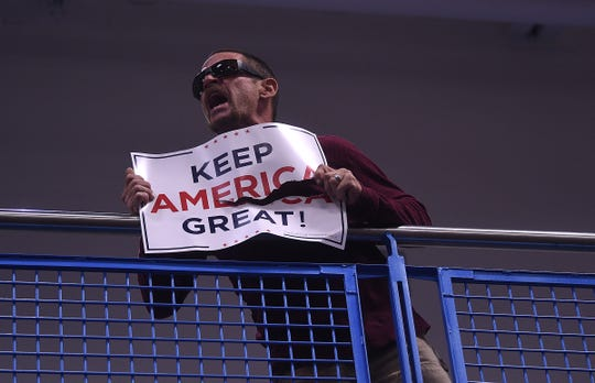 A Donald Trump supporter yells from the balcony as Senator Elizabeth Warren holds a campaign rally at the MAC Multi-Purpose Athletic Center Facility in Carson City on Oct. 2, 2019.