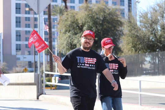 Two Trump supporters walk to the president's rally in Las Vegas on Friday, February 21.