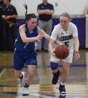 McQueen's Talia Marini, left, and Spanish Springs' Mrgan Gower chase a loose ball during Thursday's playoff game at Spanish Springs.