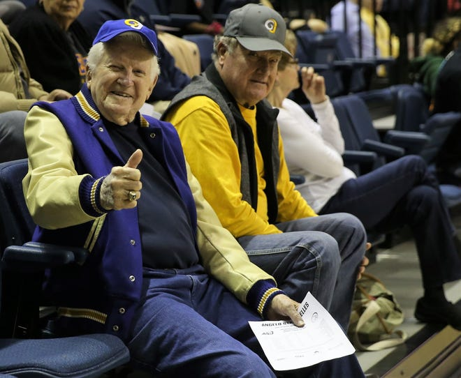 Former Angelo State University athletic director and men's head basketball coach Phil George had a front-row seat for ASU's games against Texas A&M-Kingsville at the Junell Center on Thursday, Feb. 20, 2020.  George led the 1957 team to the National Junior College Athletic Association championship. Sitting next to George is one of his former players, Alex Decuir, and his wife, Kay.