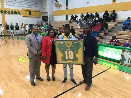 Tre'davious White (second from the right) had his Green Oaks No. 10 retired on Thursday.