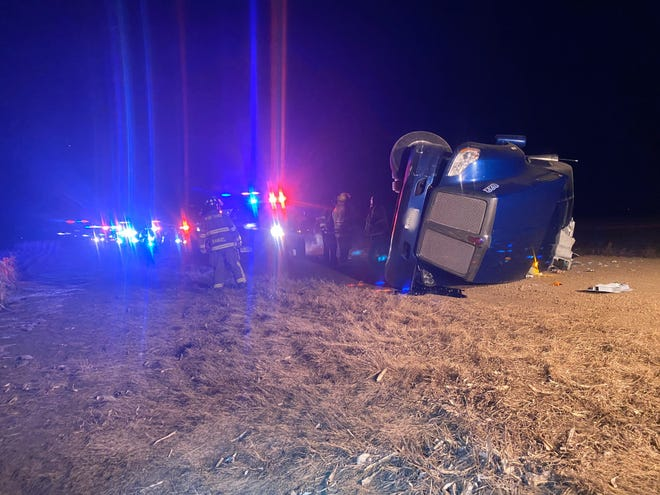 Firefighters respond to a rolled semi-truck Thursday east of the 280th Street and South Dakota Highway 15 intersection, after police say the driver led them on a 90 mph chase.