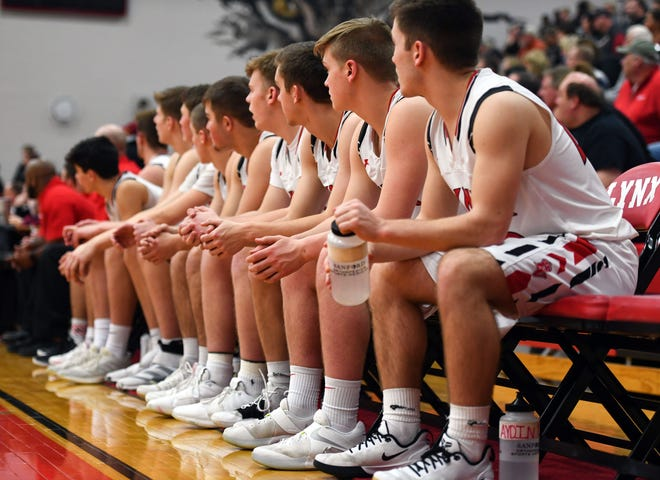 Members of the Brandon Valley boys basketball team watch the game against Roosevelt from the sidelines on Thursday, Feb. 20, at Brandon Valley High School.