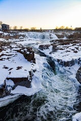 Falls Park is partially frozen as the sun sets on Thursday, Feb. 20, in Sioux Falls.