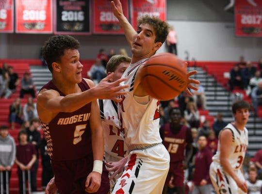 Brandon Valley's Aydin Lloyd intercepts a pass by Roosevelt's Taylen Ashley on Thursday, Feb. 20, at Brandon Valley High School.