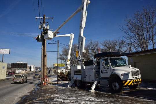 """In this early 2020 photo, a City Utilities worker completes """"make ready"""" tasks to ensure that utility poles are ready to accommodate 1,100 miles of new fiber optic capacity that will cost $120 million."""