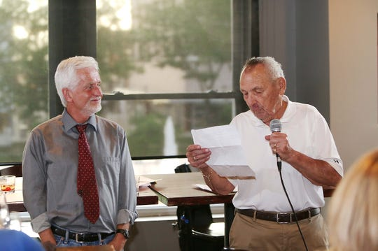 Anton Tasich, former owner of Anton's Coffee Shop, loved to write poetry.  Here, he reads a poem to News-Leader columnist Steve Pokin at the first Answer Man Live! event in 2016.  Tasich died in January at 88.