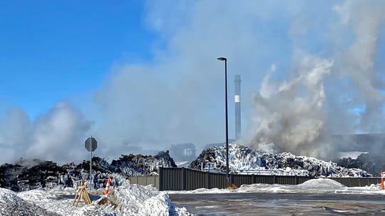 """The massive fire at Northern Metal recycling in Becker, Minnesota, that has been burning for days, seemed to be under control Thursday, Feb. 20, 2020 with massive piles of burned cars covered in ice.  The Becker Police Department posted Thursday  that """"major progress"""" has been made and that fire crews report the fire is """"under control at this point.""""  (Brian Peterson/Star Tribune via AP)"""