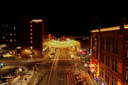 """On Saturday night, Sauk Rapids photographer Simon Thompson and a few friends were taking pictures of downtown St. Cloud. He captured this a long exposure from atop the River's Edge Convention Center parking ramp. """"This may be the last night this shot will ever look like this,"""" he said."""