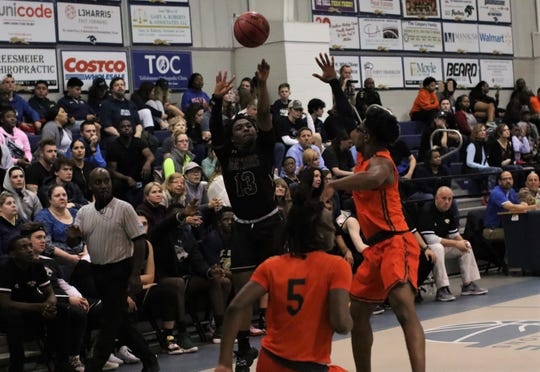 St. John Paul II senior guard Tyreke McElwain shoots a 3-pointer as FAMU DRS' boys basketball team beat St. John Paul II 79-61 in a Region 1-2A quarterfinal playoff game on Feb. 20, 2020.