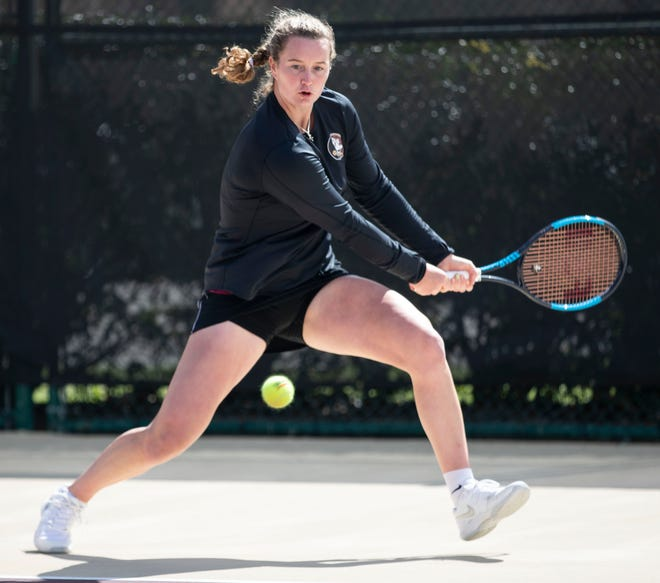 Florida State Seminoles Victoria Allen hits a backhand during a match. The No. 2 ranked Florida State Seminoles host the No. 1 ranked North Carolina Tar Heels at the Scott Speicher Tennis Center, Friday, Feb. 21, 2020.