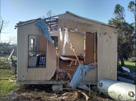 """Marina Hulsman said after the storm destroyed her mobile home, """"This is what was left of our home when we managed to get back to it. Never could've imagined that it would look like this."""""""