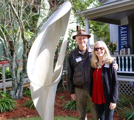 "Laurie and Kelly Dozier with Paul Tamanian Sculpture ""Poised"" unveiled at Dedication of Strauss Garden at LeMoyne on Feb. 14."