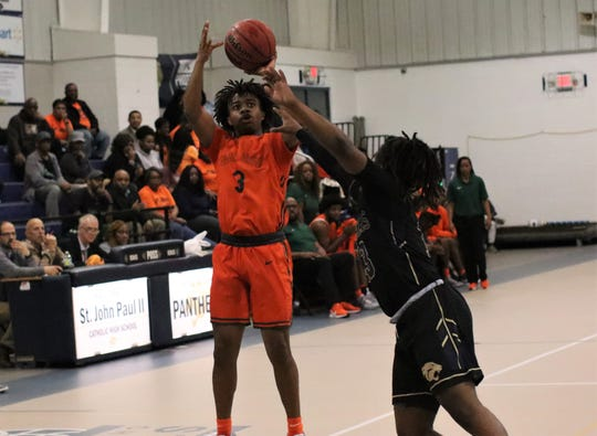 FAMU DRS junior guard Devin Thames shoots a 3-pointer as FAMU DRS' boys basketball team beat St. John Paul II 79-61 in a Region 1-2A quarterfinal playoff game on Feb. 20, 2020.
