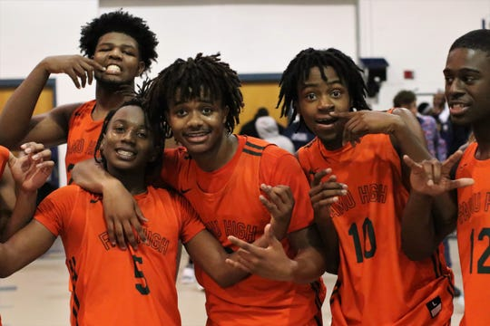 FAMU DRS basketball players Terence Card, Chris Bryant, Devin Thames, Tearrius Jackson, and Jha'Shawn Black celebrate after the Rattlers beat St. John Paul II 79-61 in a Region 1-2A quarterfinal playoff game on Feb. 20, 2020.