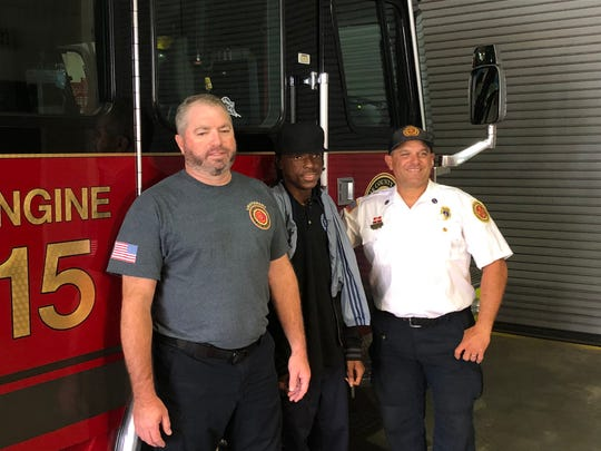 Demetrius Gollett, 15, meets Lt. Steve Burns and Lt. Chris Longo, the two firefighters who save his life from a 2013 Fort Pierce fire.