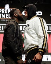 Tyson Fury, of England, right, and Deontay Wilder face off for photographers during a news conference Wednesday, Feb. 19, 2020, in Las Vegas for their upcoming WBC heavyweight championship boxing match.