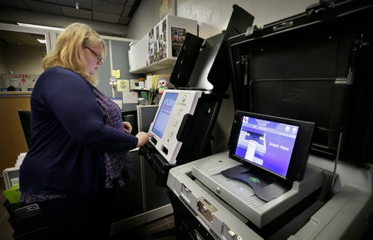El Paso County Elections Admistrator Lisa Wise demonstrates the new voting machines at her downtown El Paso office.