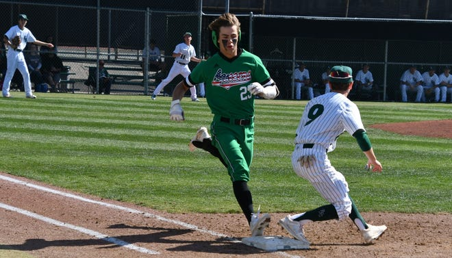 Thousand Oaks High junior Max Muncy beats out a throw to first for an infield single during a game against Granada Hills Charter on Feb. 15. Muncy is one of the top area baseball players and part of a deep and talented Lancers team.
